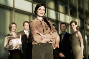 Portrait of business woman and colleagues
